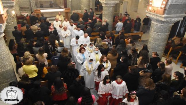 قداس عيد الدنح المقدس في كنيسة مار كوركيس ببلدة القوش